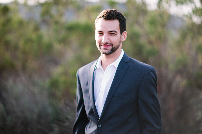 Anza valley rustic outdoor wedding at the alpaca farm groom navy blue suit with white dress shirt and no tie smiling wedding photo idea groom casual look