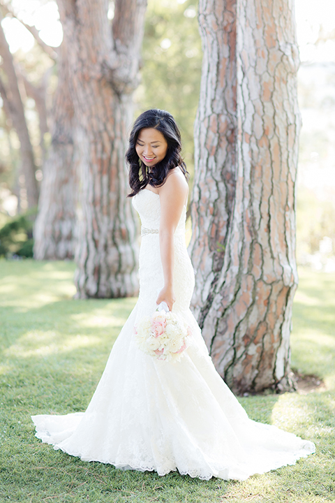 Summer outdoor wedding at south coast botanic gardens bride strapless mermaid style lace gown with sweetheart neckline and crystal belt holding white floral bridal bouquet