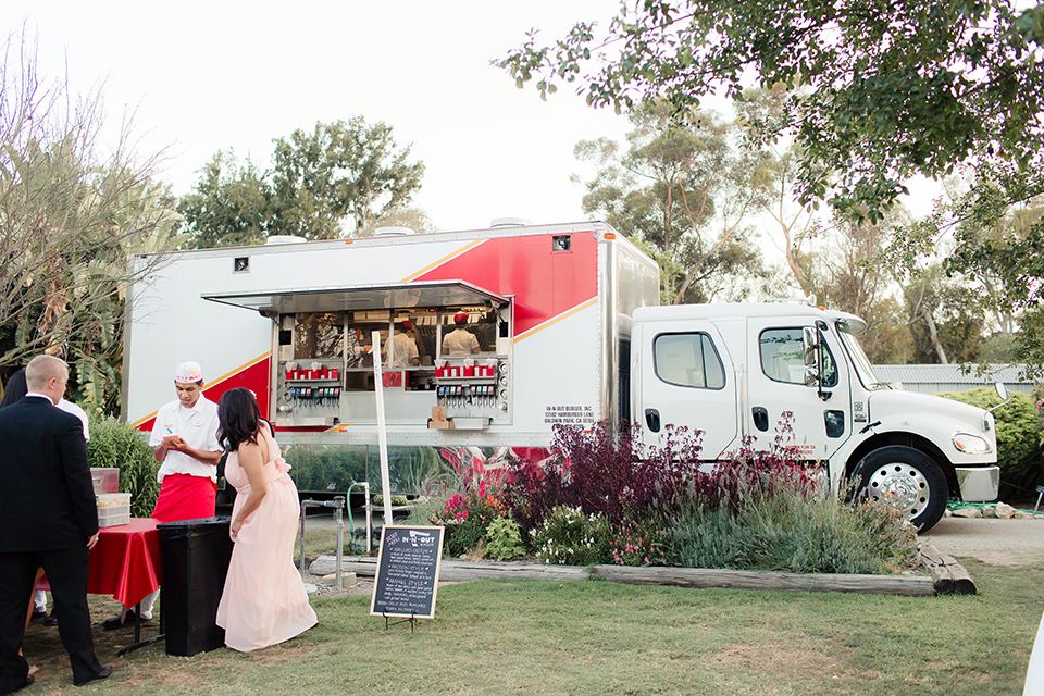 Summer outdoor wedding at south coast botanic gardens reception area with food truck in n out truck with open window and table set up for guests wedding photo idea