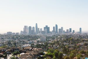 Downtown los angeles trish peng hightea at garbutt house view of downtown los angeles with buildings and city view with houses and trees in distance wedding photo idea for city and venue