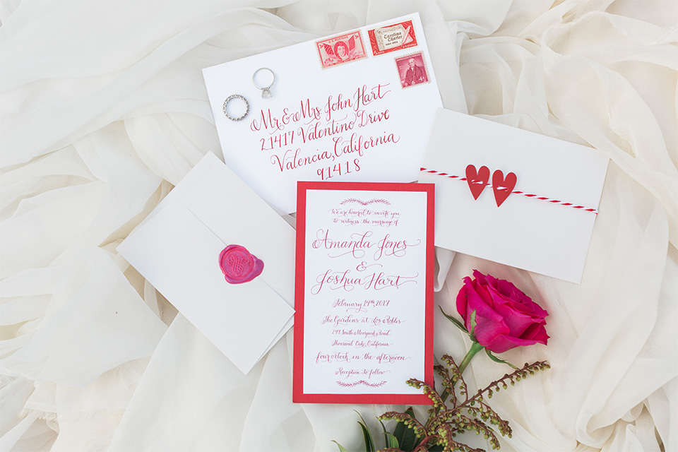 Los angeles valentine theme wedding shoot at the gardens at los robles white and pink wedding invitations with pink flower decor on white background wedding photo idea