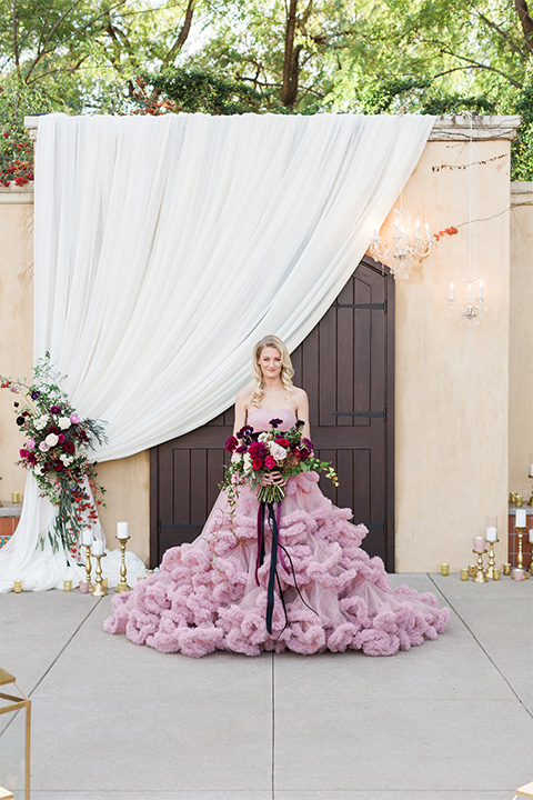 Los angeles valentine theme wedding shoot at the gardens at los robles bride pink ballgown dress with ruffled skirt and dark pink and white floral bridal bouquet