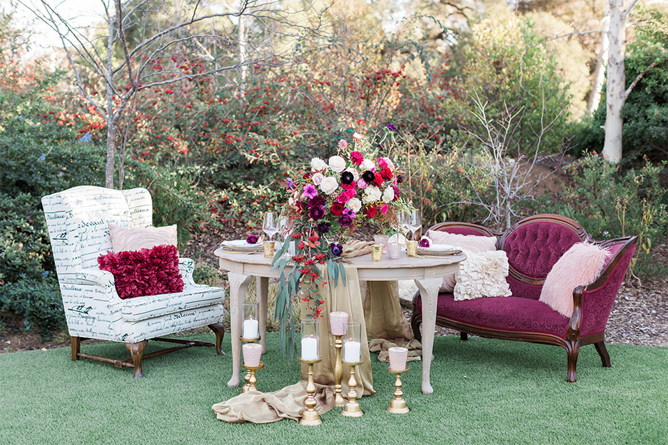 Los angeles valentine theme wedding shoot at the gardens at los robles vintage red and white lounge furniture with table and flower deocr