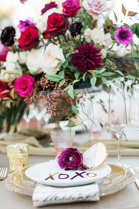 Los angeles valentine theme wedding shoot at the gardens at los robles vintage red and white lounge furniture with table and flower deocr and white and gold place settings with gold silverware