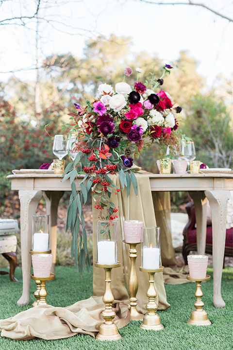 Los angeles valentine theme wedding shoot at the gardens at los robles vintage red and white lounge furniture with table and flower deocr and white and gold place settings with gold silverware and white candle decor
