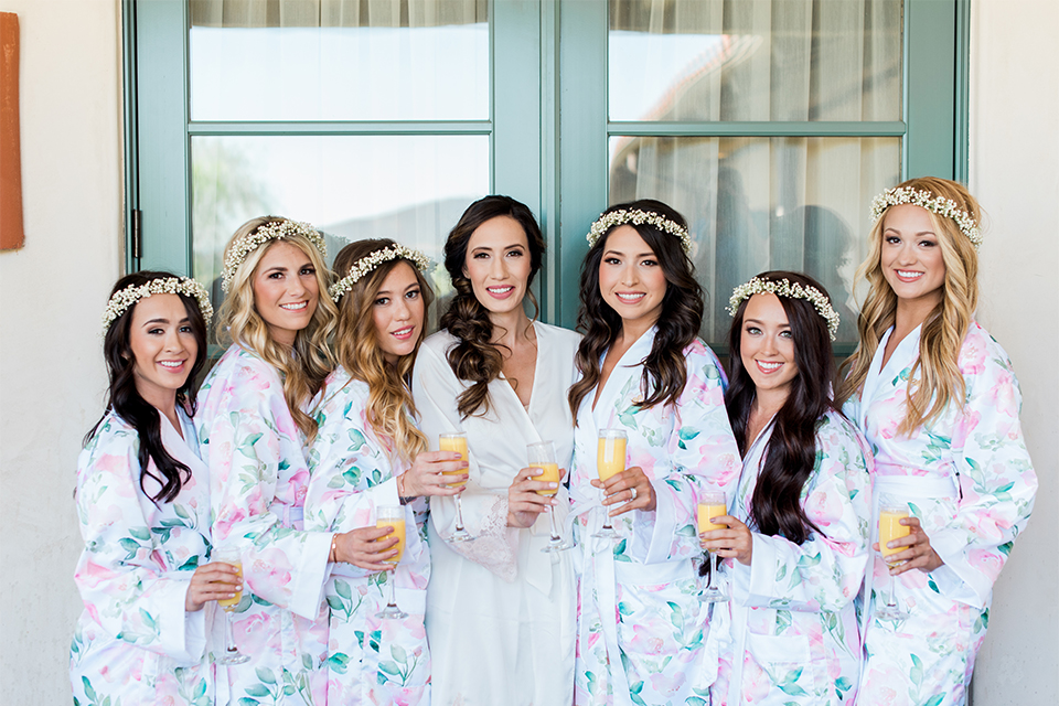 Temecula outdoor wedding at ponte winery bride white silky robe with bridesmaids light blue floral silk robes getting ready before ceremony