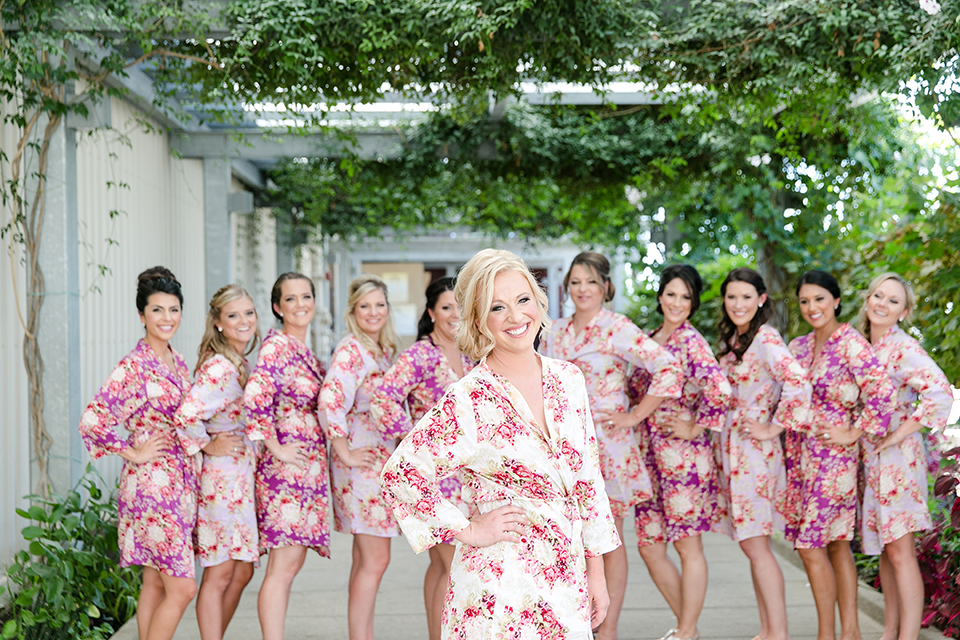 Temecula outdoor wedding at callaway winery bride white and pink floral silk robe getting ready with bridesmaids pink floral silk robes wedding photo idea for bride and bridesmaids
