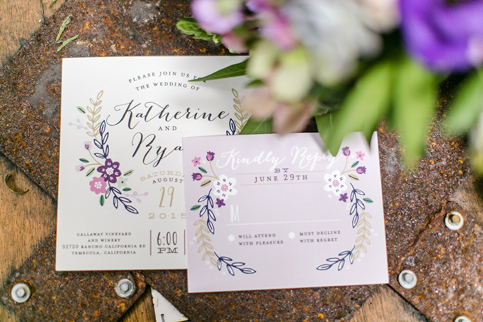 Temecula outdoor wedding at callaway winery white wedding invitations with purple flower decor on light brown background wedding photo idea for invitations