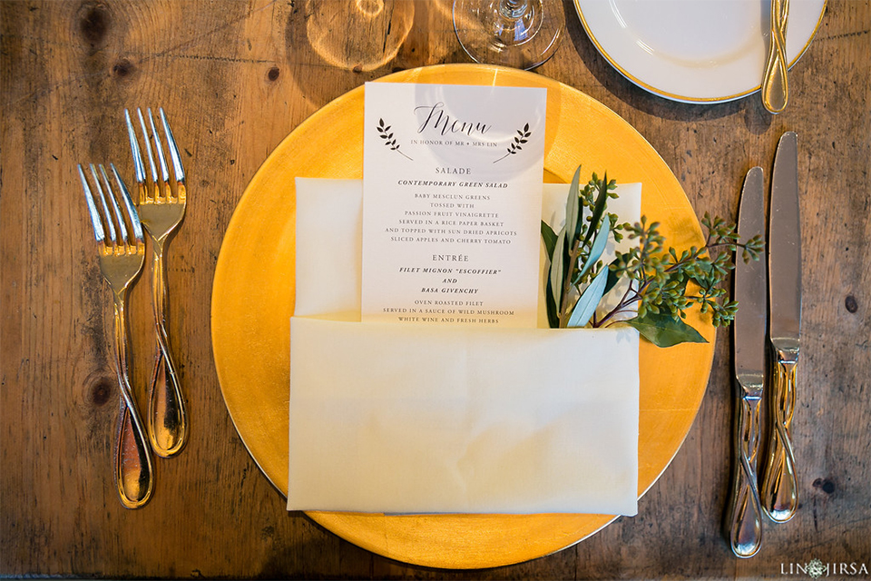 Downtown los angeles wedding table set up light gold table linen with gold chairs and white and green flower centerpiece decor with white and gold place settings with white napkin linen wedding photo idea