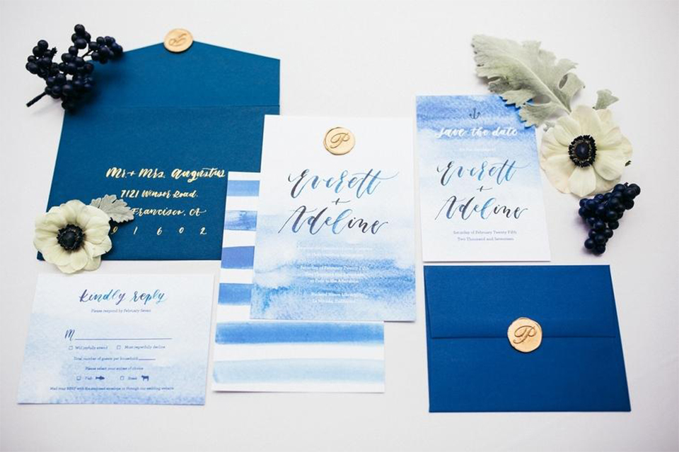 Orange county nautical navy wedding at the nixon library wedding invitations white and blue invitations with watercolor design and blue calligraphy writing with blue envelopes and gold seals on white background wedding photo idea for invitations