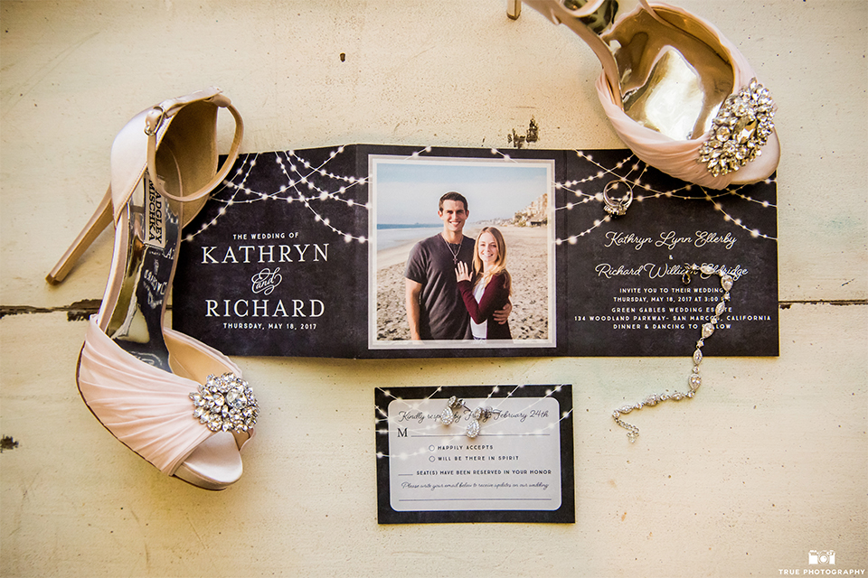 San diego wedding at green gables estate black and white wedding invitations with shoes and jewelry decor on ivory background wedding photo idea for invitations