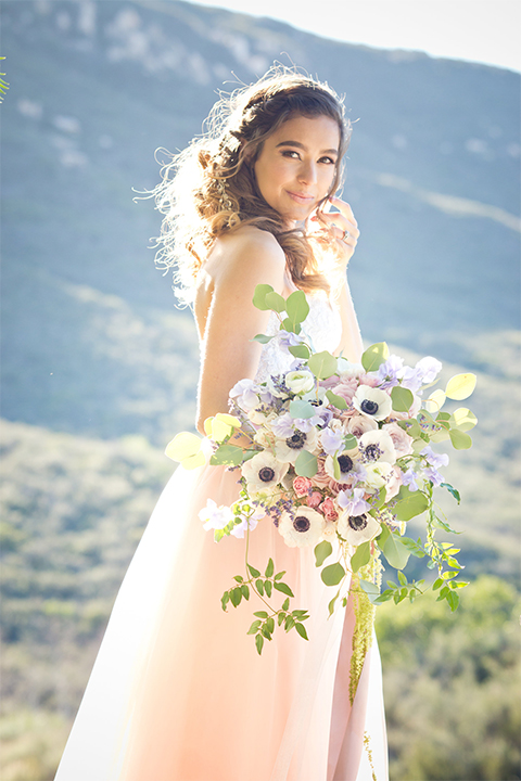 San diego outdoor woodland wedding shoot bride blush pink chiffon strapless gown with a sweetheart neckline holding white floral bridal bouquet