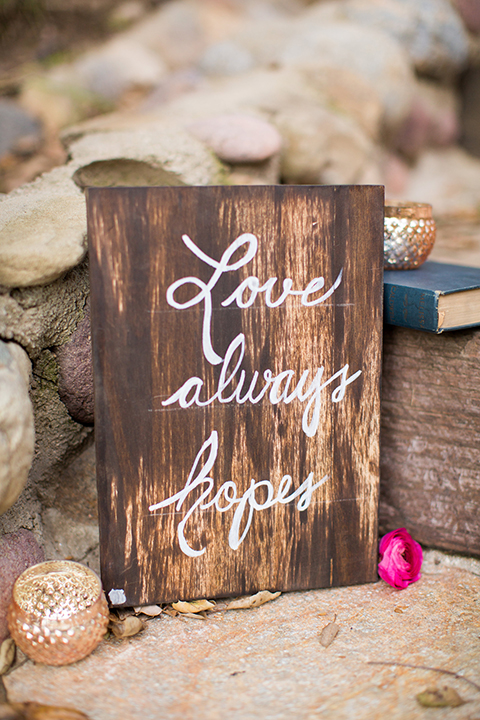 Rancho las lomas outdoor engagement shoot ceremony set up with decor light brown wood sign with white calligraphy writing and love quote for the aisle on steps for ceremony decor wedding photo idea