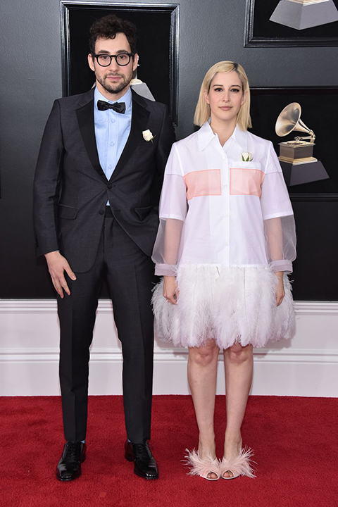 2018 grammys jack antonoff navy blue tuxedo with a light blue dress shirt and black bow tie with a white flower lapel pin