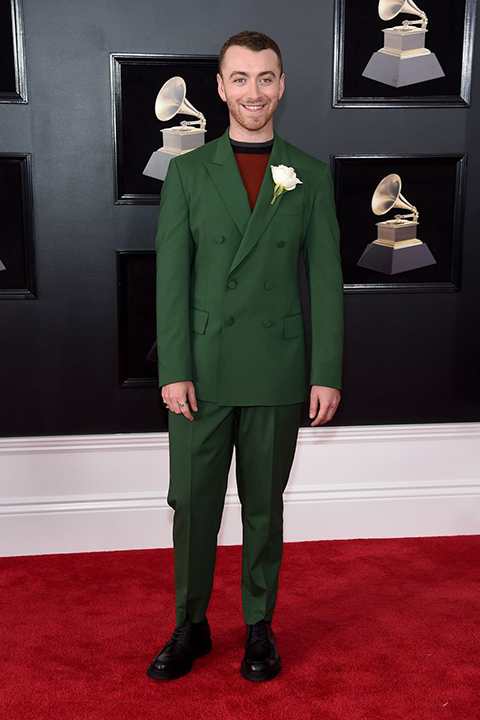 2018 grammys sam smith hunter green tuxedo with a red and black shirt underneath and white floral boutonniere