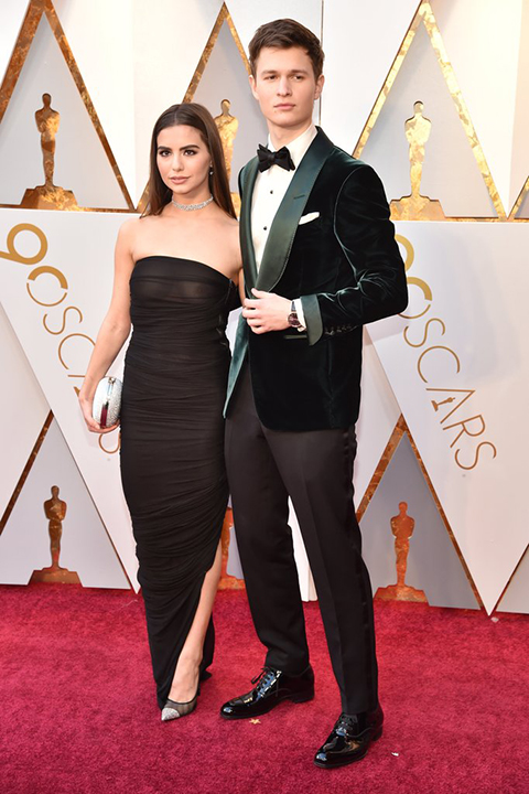 2018 academy awards ansel elgort forest green velvet tuxedo coat with black pants and a black bow tie with a white dress shirt