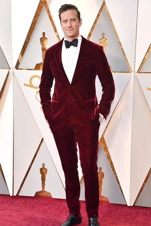 2018 academy awards armie hammer burgundy velvet tuxedo with a white dress shirt and a classic black bow tie