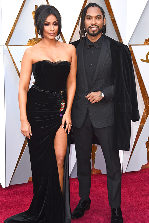 2018 academy awards miguel black shawl lapel tuxedo with a black dress shirt and black bow tie with a black velvet coat on top