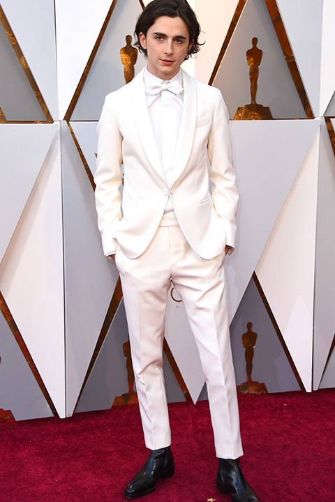 2018 academy awards timothee chalamet white tuxedo look with white dress shirt and white bow tie with black tuxedo shoes