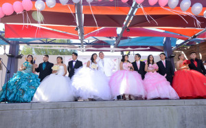 Quinceanera, quince, Chambelan, chambelanes, quince girl, 15th birthday, Quinceanera.com, black Monterey tuxedo, classic black tuxedo, tuxedo with notch lapel chambelan outfit, chambelanes outfit, black Lorenzo tuxedo, tuxedo with shawl lapel, what to dress your chambelanes in, black desire tuxedo, Michael kors tuxedo, white Casablanca dinner jacket, Spanish culture, Spanish tradition, birthday celebration, quince girls on stage