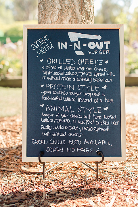 Summer outdoor wedding at south coast botanic gardens black and white chalkboard sign with food menu and in n out secret items wedding photo idea