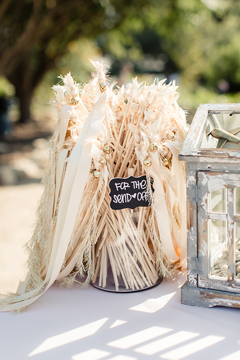 Summer outdoor wedding at south coast botanic gardens white table linen with decor and crystal jar with black sign for sign off with ribbon decor