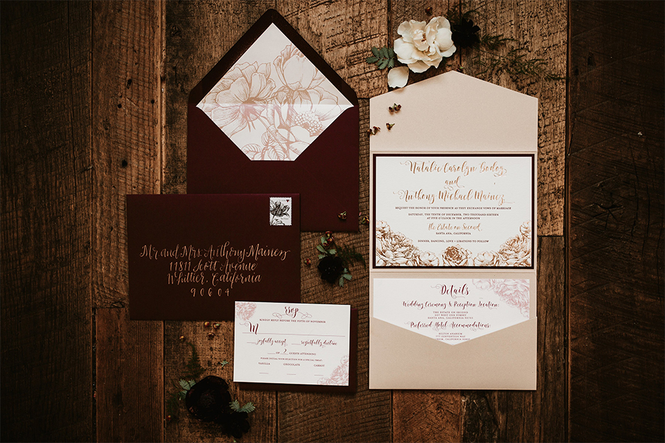 Orange county wedding at the estate on second wedding invitations white with black border and black and tan envelopes with gold writing design and flower decor on dark brown hardwood floor wedding photo idea for invitations