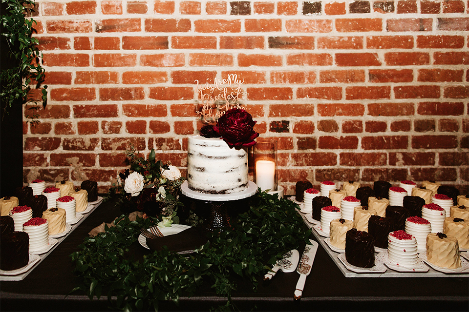 Orange county wedding at the estate on second dessert table with one tier white naked wedding cake with dark red flowwer decor on top and gold calligraphy writing cake topper and dessert on the side