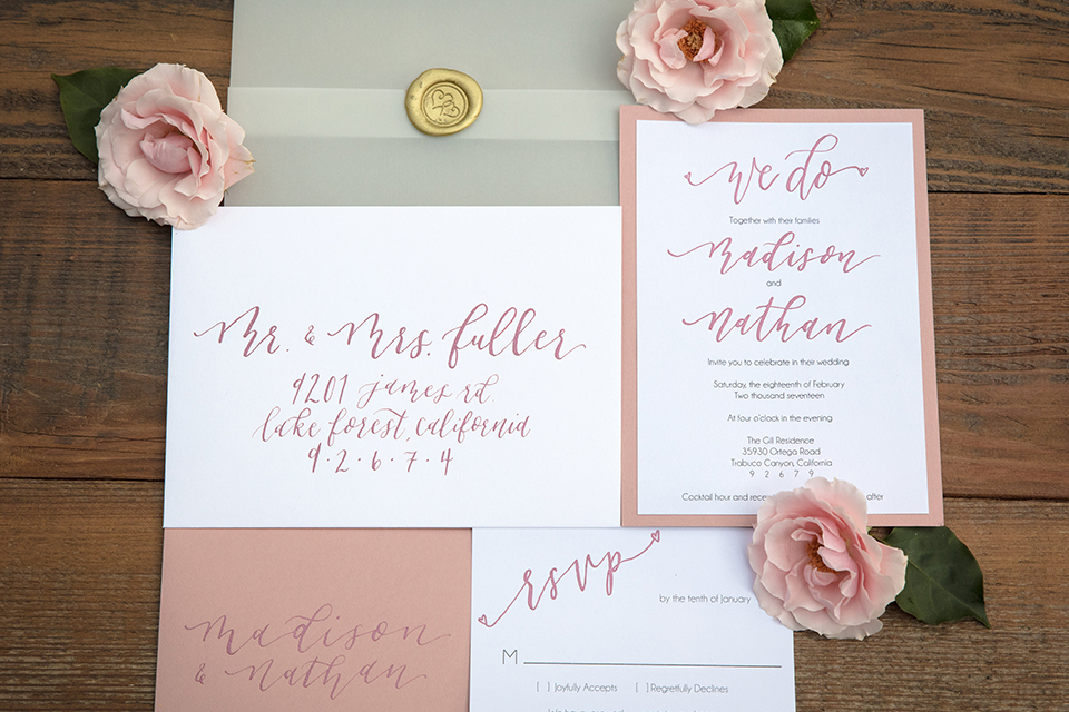 Valentine styled wedding shoot white and pink wedding invitations with pink flower decor on light grey background wedding photo idea for wedding invitations