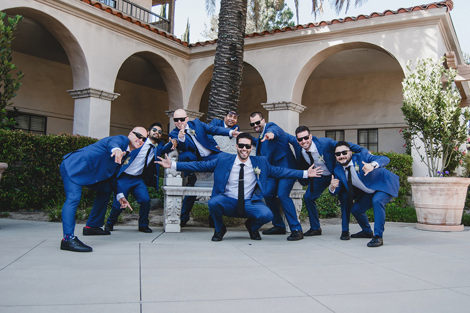 Orange county wedding at the colony house groom cobalt blue suit with matching vest and white dress shirt with long black skinny tie and white floral boutonniere with groomsmen cobalt blue suits with matching vests and white dress shirts with long black skinny ties wearing sunglasses