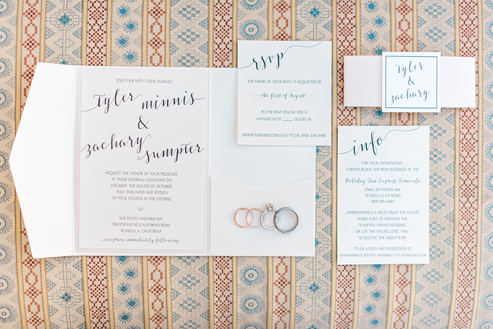 Temecula outdoor wedding at ponte winery wedding invitations white with black calligraphy writing and blue patterned background with wedding rings wedding photo idea