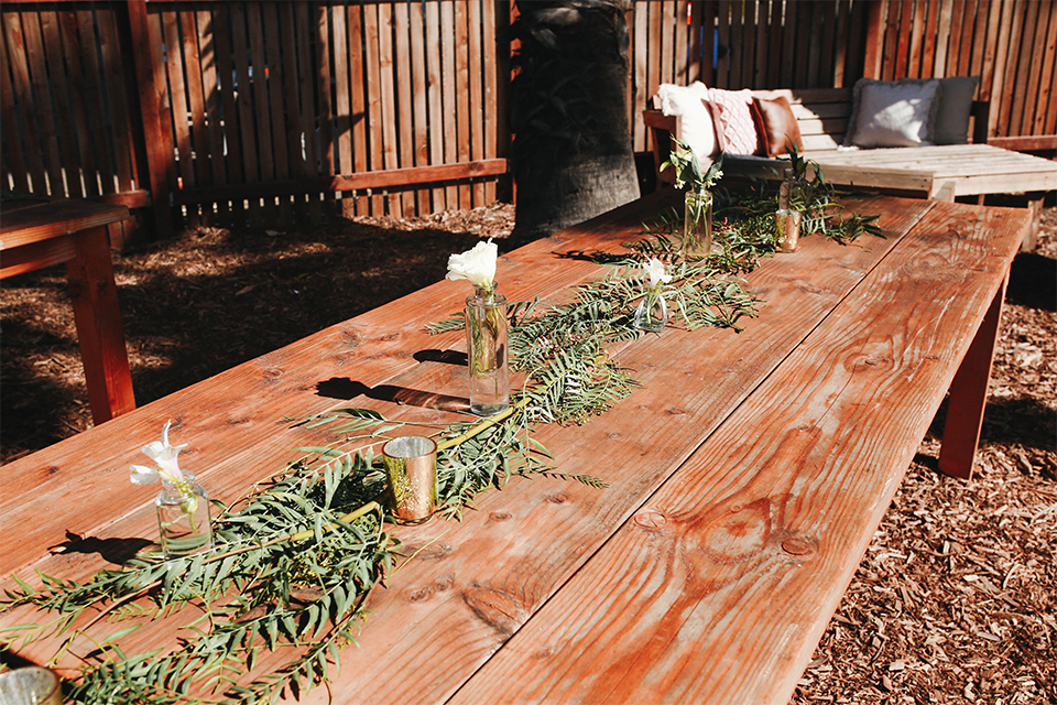 Orange county outdoor rustic wedding at the riverbed farm table set up dark brown wood table with white and greenery flower centerpiece decor with candles and glasses plain and simple table set up wedding photo idea