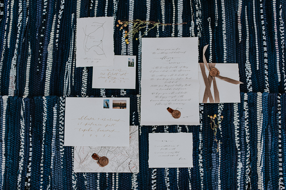San diego outdoor wedding shoot at the san diego zoo and safari park wedding invitations white invitations with black writing and blue and white striped background wedding photo idea for invitations