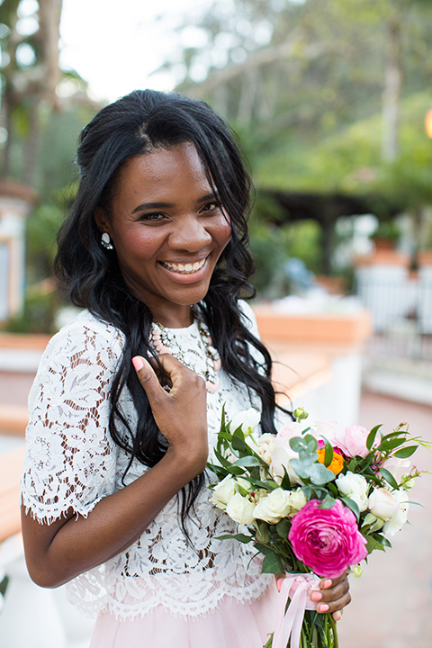 Rancho las lomas outdoor engagement shoot bride light pink tulle skirt with a white lace short sleeve top holding white and pink floral bridal bouquet smiling and laughing