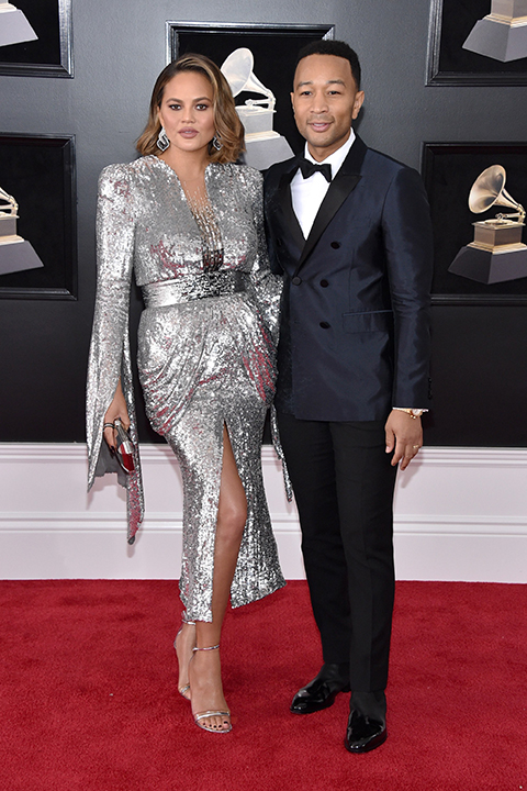 2018 grammys john legend and chrissy teigen navy blue tuxedo with black pants and a white dress shirt with a black bow tie