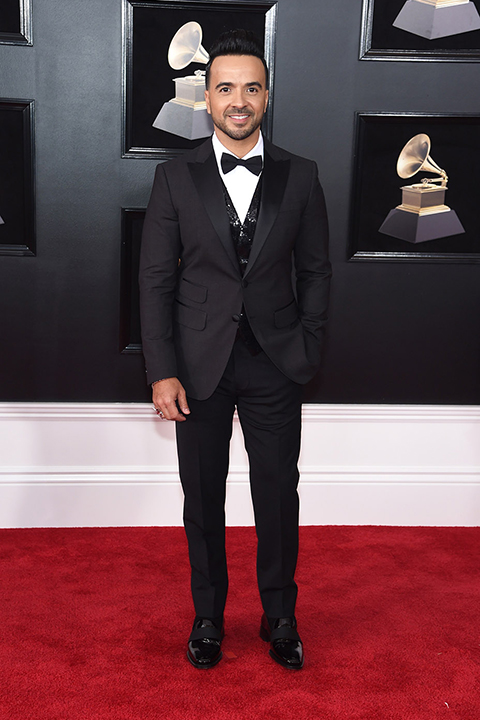 2018 grammys luis fonsi black tuxedo with a white dress shirt and black bow tie with a black sequined vest