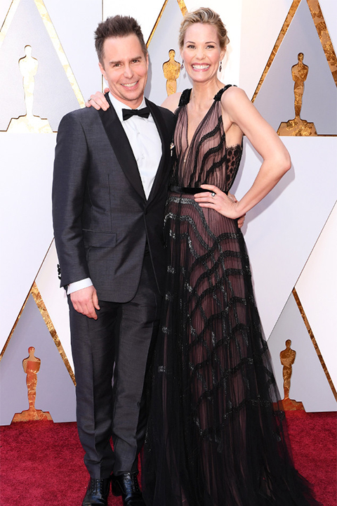 2018 academy awards sam rockwell charcoal grey tuxedo with black shawl lapels and white dress shirt with a classic black bow tie